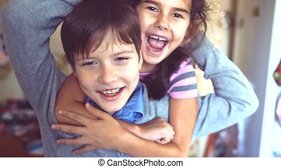 little boy and girl hugging do selfie. boy with a girl hugging children friendship concept. little cute boy and girl hugging playing on in the room lifestyle indoors
