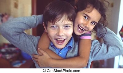 little boy and girl hugging do selfie. boy with a girl hugging children friendship concept. little cute boy and girl hugging playing on in the room indoors lifestyle