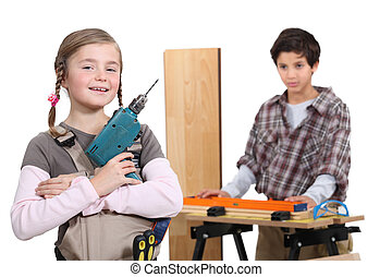 little boy and girl in a craftsman workshop