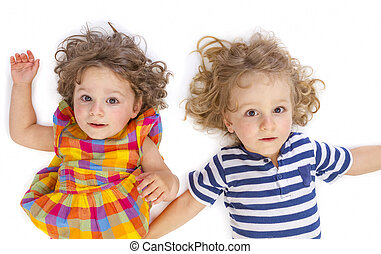 Little boy and girl looking at camera