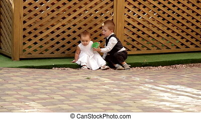 little boy and girl playing