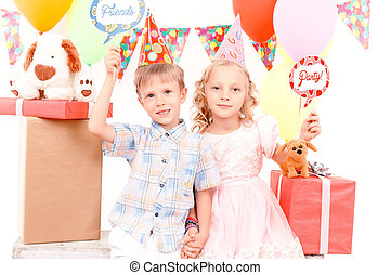 Little boy and girl posing during birthday party