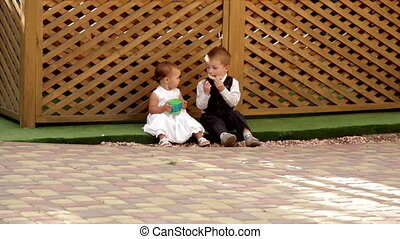 little boy and girl sitting