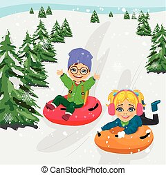 little boy and girl sliding down hill on tubes - little boy...