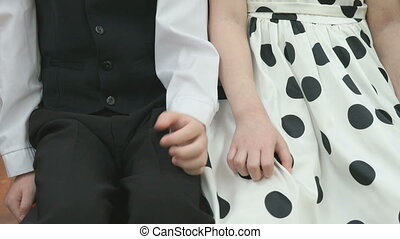 Little boy and girl taking hands in kindergarten