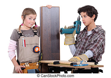 Little boy and girl with power tools