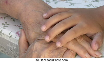 Little boy and grandmother Hands