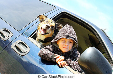 Little Boy and His Dog Hanging Out Minivan Window