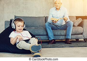 Little boy and his grandpa involved in different activities