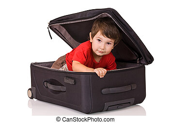 Little boy and suitcase