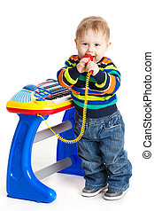 little boy and the keyboard on white background. funny boy baby. young DJ