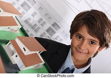 Little boy architect in office