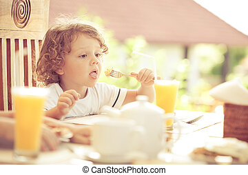 little boy at breakfast