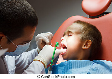 Little boy at dentist - Little boy sitting at dentist for...