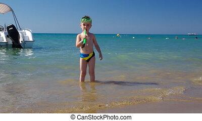 .Little boy at sand beach.