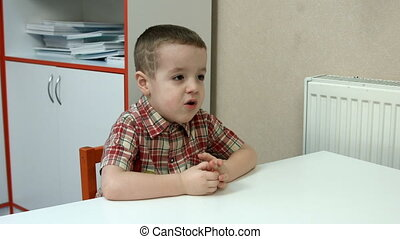 Little boy at the Desk