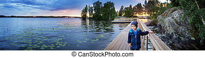 Little boy at the lake in Tampere, Finland.