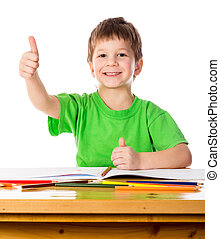 Little boy at the table with thumb up sign