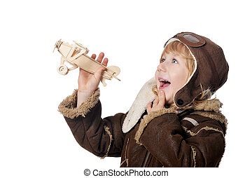 Little boy aviator wit wooden plane toy