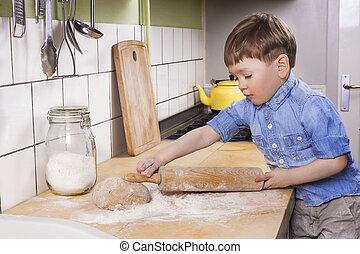Little boy baking in the kitchen.
