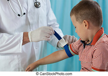 Little boy before taking blood sample