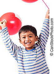 little boy blow up balloon