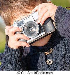 Little Boy Capturing Photo With Camera
