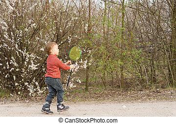 Little boy catching a frisbee