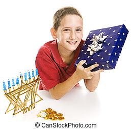 Little Boy Celebrates Chanukah - Adorable little boy with a...