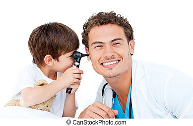 Little boy checking doctor\'s ears