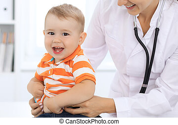Little boy child  at health exam at doctor's office