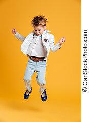 Little boy child jumping