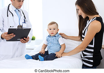 Little boy child  with his mother  at  health exam at doctor's office