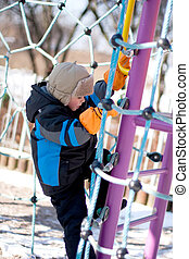 Little boy  climbing on playground