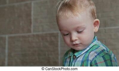 Little boy close up look around