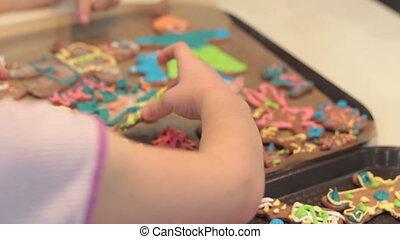 Little boy cooking gingerbread cookies.