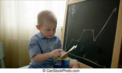 Little Boy Counting Dollar Notes