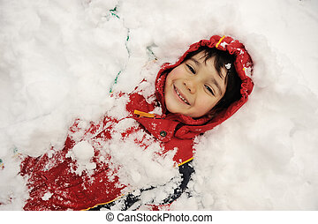 Little boy covered with snow