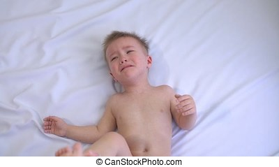 Little boy crying on a white background. Dependence on computer games