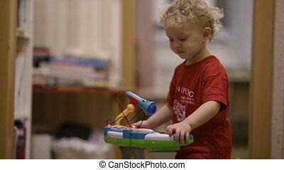 Little boy dancing. - Little boy dancing to music of his ...