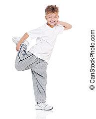 Little boy dancing on white