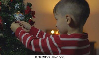 Little Boy Decorate Chrismass Tree