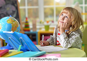 Little boy does homework