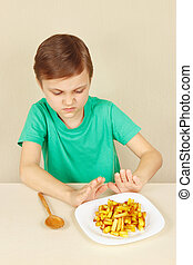 Little boy does not want to eat french fries