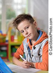 little boy doing lessons
