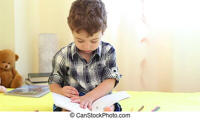 Little boy drawing his hand