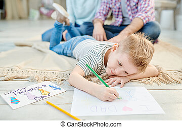 Little Boy Drawing Picture for Fathers Day