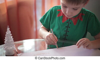 Little boy drawing with colored pencils 3