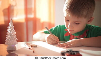Little boy drawing with colored pencils 6
