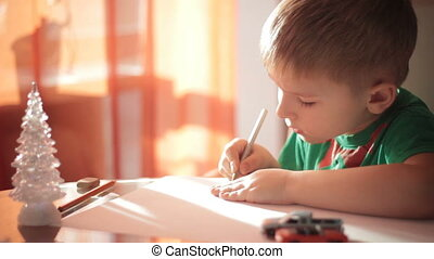 Little boy drawing with colored pencils 5